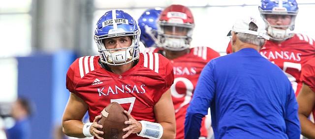 Kansas quarterback Thomas MacVittie pulls back to pass during practice on Thursday, Aug. 8, 2019.