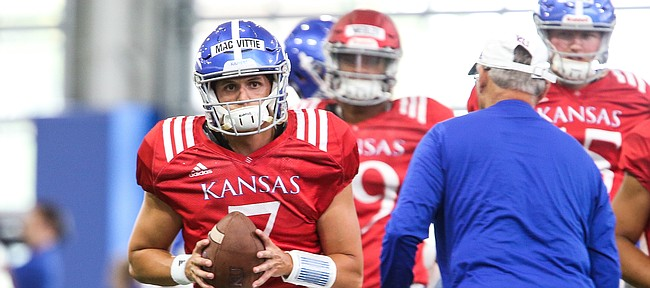 Kansas quarterback Thomas MacVittie pulls back to pass during practice on Thursday, Aug. 8, 2019.