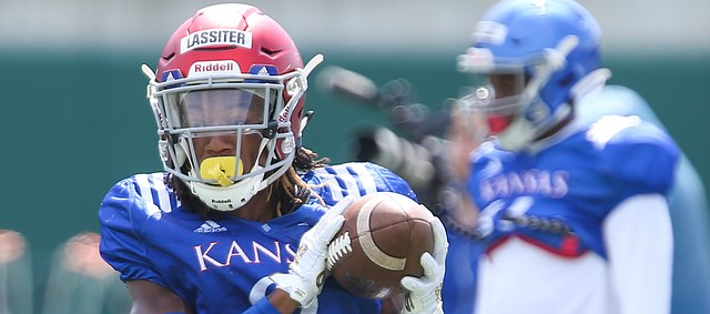 Kansas receiver Kwamie Lassiter II catches a pass during practice on Friday, Aug. 9, 2019.