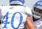 Kansas linebacker Kyron Johnson works on technique with fellow position player Dru Prox during practice on Friday, Aug. 9, 2019.