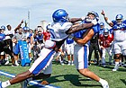Kansas linebacker Azur Kamara (5) goes head-to-head with tight end Jack Luavasa in the Jayhawk drill during practice on Friday, Aug. 9, 2019.