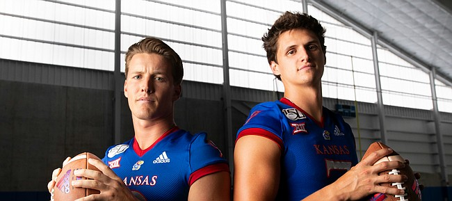 Kansas quarterbacks Carter Stanley, left, and Thomas MacVittie are pictured during KU football Media Day on Friday, Aug. 16, 2019 at the indoor practice facility.