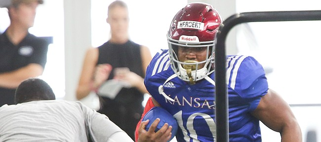 Kansas running back Khalil Herbert makes a move during practice on Thursday, Aug. 8, 2019.