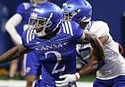 Kansas receiver Daylon Charlot breaks free from a defender on Thursday, April 4, 2019 at the indoor practice facility.