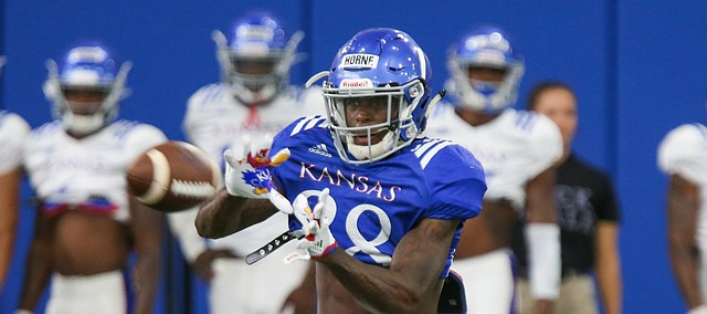 Kansas receiver Jamahl Horne pulls in a pass during practice on Thursday, Aug. 8, 2019.