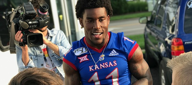 Kansas senior safety Mike Lee speaks with a group of young fans on Friday, Aug. 23, 2019, during the athletic department's annual KU Kickoff at Corinth Square, in Prairie Village.