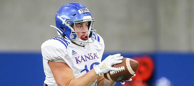 Kansas freshman linebacker Gavin Potter pulls in a catch during practice on Thursday, Aug. 8, 2019.