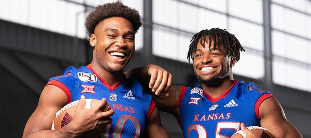 Kansas runningbacks Khalil Herbert, left, and Dom Williams are pictured during KU football Media Day on Friday, Aug. 16, 2019 at the indoor practice facility.