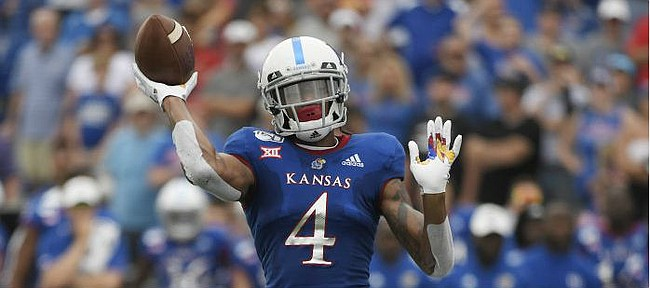 Kansas wide receiver Andrew Parchment throws a two-point conversion in the fourth quarter against Indiana State Saturday afternoon at David Booth Kansas Memorial Stadium on Aug. 31, 2019.