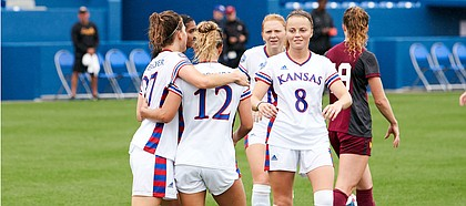 KU teammates Sophie Maierhofer (27), Katie McClure (12) and Ebba Costow (8) celebrate a goal during the team's 6-0 win over Loyola Chicago Sunday afternoon at Rock Chalk Park on Aug. 25, 2019.