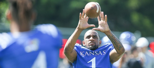Kansas running back Pooka Williams catches a pass on the sidelines during practice on Friday, Aug. 9, 2019.