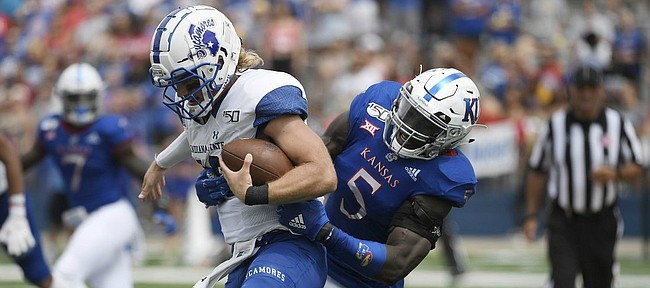 Kansas linebacker Azur Kamara takes down Indiana State's quarterback Ryan Boyle Saturday afternoon at David Booth Kansas Memorial Stadium on Aug. 31, 2019.