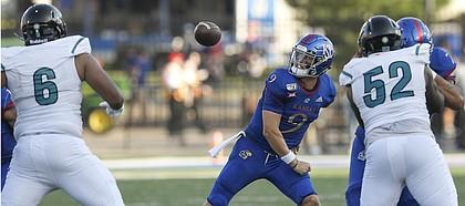 Kansas quarterback Carter Stanley fumbles the ball as he tries to make a pass against Coastal Carolina Saturday night at David Booth Kansas Memorial Stadium on Sept. 7, 2019.