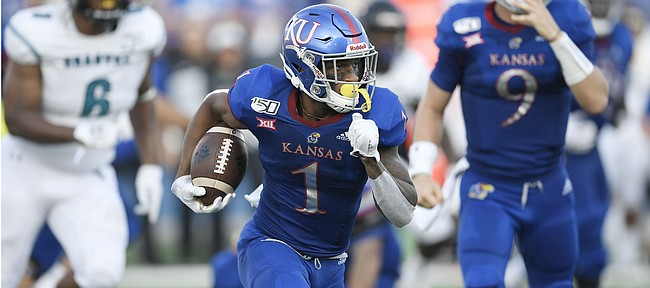 Kansas running back Pooka Williams Jr. makes a run against Coastal Carolina Saturday night at David Booth Kansas Memorial Stadium on Sept. 7, 2019.