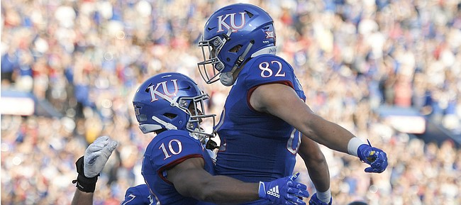Kansas running back Khalil Herbert celebrates scoring a touchdown with tight end James Sosinski Saturday night at David Booth Kansas Memorial Stadium on Sept. 7, 2019.