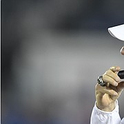 Kansas head coach Les Miles talks on the radio to assistants Saturday against Coastal Carolina Saturday night at David Booth Kansas Memorial Stadium on Sept. 7, 2019.