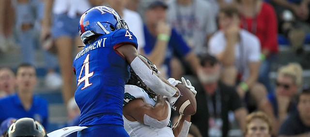 Coastal Carolina cornerback Chandler Kryst (13) intercepts a pass intended for Kansas wide receiver Andrew Parchment (4) during the first half of an NCAA college football game in Lawrence, Kan., Saturday, Sept. 7, 2019. (AP Photo/Orlin Wagner)