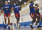 KU grad transfer Isaiah Moss, second from left, runs sprints with his teammates during boot camp in the KU practice gym earlier this week.