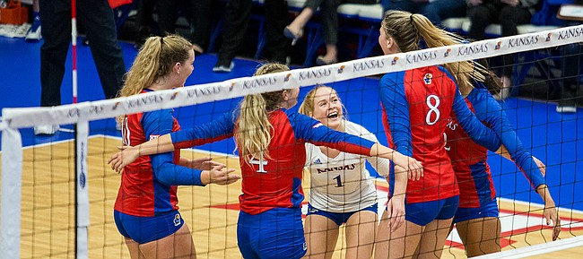 Senior libero Allie Nelson (1) celebrates with her team. KU defeated Morehead State 3-0 Thursday, Sept. 12.