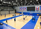 The Kansas volleyball team practices on a new Taraflex floor featuring the Jayhawk logo at the new Horejsi Family Volleyball Arena on Wednesday, Sept. 11, 2019.