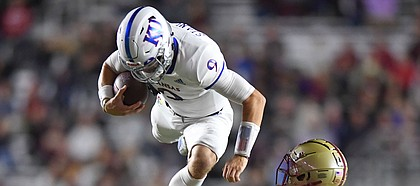(Boston, MA, 09/13/19) Kansas Jayhawks quarterback Carter Stanley (9) hurdles over Boston College defenders Tate Haynes (7) and Nolan Borgersen during the first half of an NCAA football game at Boston College in Boston, Mass., on Friday, September 13, 2019.