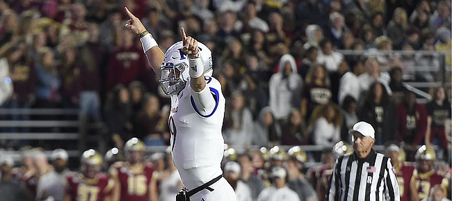 (Boston, MA, 09/13/19) Kansas Jayhawks quarterback Carter Stanley (9) celebrates a touchdown against the Boston College Eagles during the first half of an NCAA football game at Boston College in Boston, Mass., on Friday, September 13, 2019.