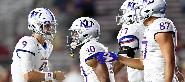 (Boston, MA, 09/13/19) Kansas Jayhawks teammates Carter Stanley, left, Khalil Herbert, Andru Tovi, and Jack Luavasa celebrate a touchdown against the Boston College Eagles during the second half of an NCAA football game in Boston, Mass., on Friday, September 13, 2019.