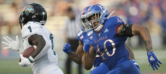 Kansas linebacker Dru Prox chases down Coastal Carolina's CJ Marable Saturday night at David Booth Kansas Memorial Stadium on Sept. 7, 2019.