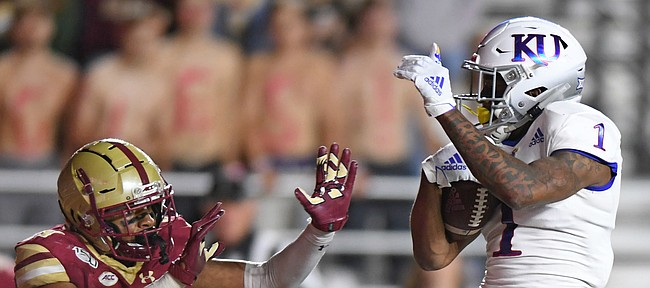 (Boston, MA, 09/13/19) Kansas Jayhawks running back Pooka Williams Jr. (1) scores a touchdown over Boston College Eagles defensive back Mehdi El Attrach (25) during the third quarter of an NCAA football game at Boston College in Boston, Mass., on Friday, September 13, 2019.
