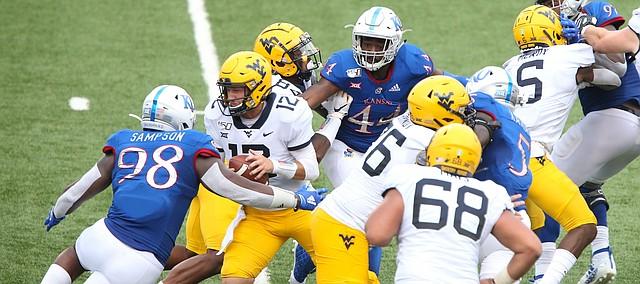 Kansas defensive tackle Caleb Sampson (98) comes in to sack West Virginia quarterback Austin Kendall (12) during the second quarter on Saturday, Sept. 21, 2019 at David Booth Kansas Memorial Stadium.