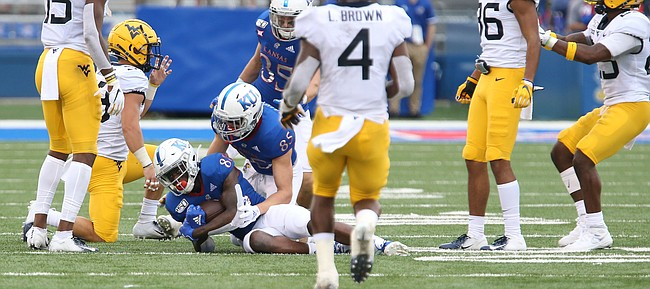 Kansas wide receiver Jamahl Horne (88) falls on an onside kick during the third quarter on Saturday, Sept. 21, 2019 at David Booth Kansas Memorial Stadium. Interference was called on the play and the ball was awarded to West Virginia.
