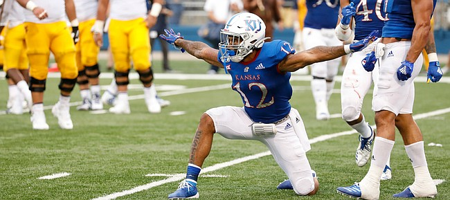 Kansas safety Jeremiah McCullough (12) celebrates after breaking up a pass deep in the Jayhawks' territory during the fourth quarter on Saturday, Sept. 21, 2019 at David Booth Kansas Memorial Stadium.