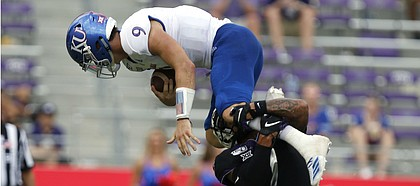 Kansas Jayhawks quarterback Carter Stanley (9) tries to leap over TCU Horned Frogs safety Trevon Moehrig (7) in the fourth quarter as the Kansas Jayhawks play the TCU Horned Frogs at Amon Carter Stadium in Fort Worth, Texas Saturday, Sept. 28, 2019.   (David Kent/Star-Telegram via AP)