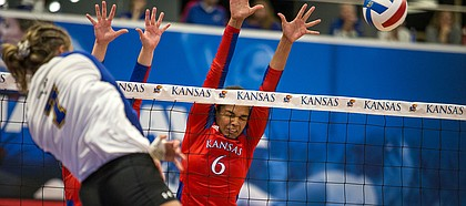 KU volleyball senior middle blocker Zoe Hill goes up for a block against Morehead State. KU defeated Morehead State 3-0 Thursday, Sept. 12.