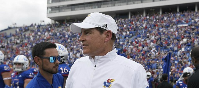 Kansas head coach Les Miles walks on the field after defeating Indiana State Saturday afternoon at David Booth Kansas Memorial Stadium on Aug. 31, 2019.