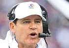 Kansas head coach Les Miles gets the attention of an official during the second quarter on Saturday, Oct. 5, 2019 at Memorial Stadium.