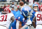Kansas quarterback Carter Stanley (9) throws as Oklahoma linebacker Jalen Redmond (31) and Oklahoma defensive lineman Neville Gallimore (90) close in during the third quarter on Saturday, Oct. 5, 2019 at Memorial Stadium.