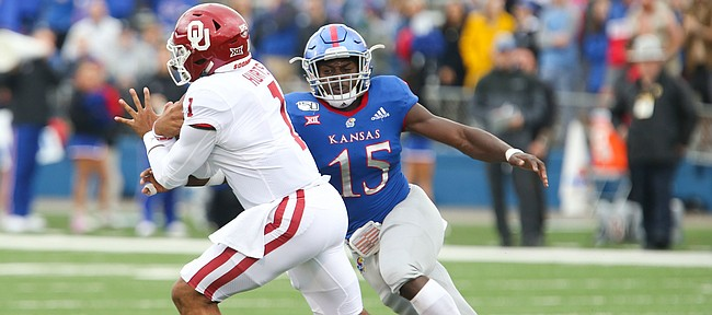 Kansas linebacker Kyron Johnson (15) chases Oklahoma quarterback Jalen Hurts (1) during the first quarter on Saturday, Oct. 5, 2019 at Memorial Stadium.