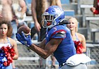 Kansas wide receiver Stephon Robinson Jr. (5) reaches to pull in a touchdown pass during the fourth quarter on Saturday, Oct. 5, 2019 at Memorial Stadium.