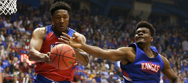 Kansas forward David McCormack (33) and Kansas center Udoka Azubuike (35) battle for a ball during Late Night in the Phog on Friday, Oct. 4, 2019 at Allen Fieldhouse.