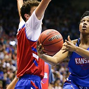 Kansas guard Brooklyn Mitchell gets in for a bucket during a Late Night in the Phog scrimmage on Friday, Oct. 4, 2019 at Allen Fieldhouse.
