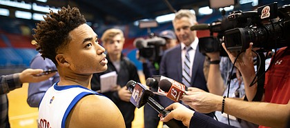 Kansas guard Devon Dotson takes questions from media members during Media Day on Wednesday, Oct. 9, 2019 at Allen Fieldhouse.