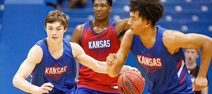 Kansas guard Christian Braun heads up the court with the ball during a scrimmage on Tuesday, June 18, 2019 at Allen Fieldhouse.