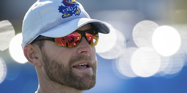 New Kansas offensive coordinator Brent Dearmon surveys the action during a recent KU football practice. Dearmon was promoted from offensive consultant to O.C. on Sunday, Oct. 6, 2019, and is the process of preparing for his first game in his new role.
