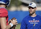 New Kansas offensive coordinator Brent Dearmon breaks down a drill with the KU quarterbacks, including starter Carter Stanley, during a recent practice.