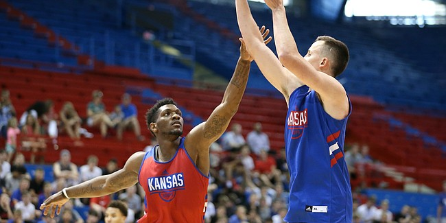 Kansas forward Silvio De Sousa defends against a three from Kansas forward Mitch Lightfoot during a scrimmage on Tuesday, June 11, 2019 at Allen Fieldhouse.