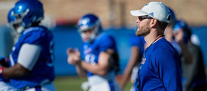 New Kansas offensive coordinator Brent Dearmon watches a play during a recent KU football practice. Dearmon was promoted from offensive consultant to O.C. on Sunday, Oct. 6, 2019, and is the process of preparing for his first game in his new role.