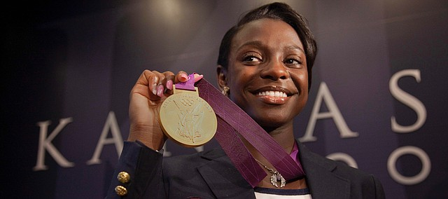 In this Journal-World file photo from Aug. 15, 2012, then-University of Kansas track star and Olympic athlete Diamond Dixon holds her gold medal during a press conference.