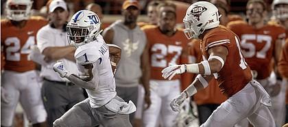 Kansas running back Pooka Williams Jr. (1) runs the ball as Texas defensive back Brandon Jones (19) pursues during an NCAA college football game Saturday, Oct. 19, 2019, in Austin, Texas. (Nick Wagner/Austin American-Statesman via AP)