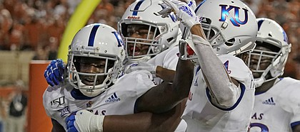 Kansas' Daylon Charlot (2) celebrates with teammates after catching a 2-point conversion during the second half of the team's NCAA college football game against Texas in Austin, Texas, Saturday, Oct. 19, 2019.